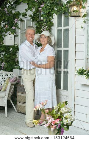 Happy Elderly couple together at summer house terrace