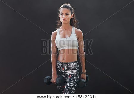 Fitness Female Doing Bodybuilding Training With Weights
