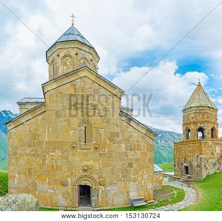 The facade of Gergeti Trinity Church with the Gate Chapel from the right Kazbegi National Park Georgia.