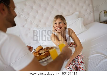 Romantic couple breakfast in bed on honeymoon