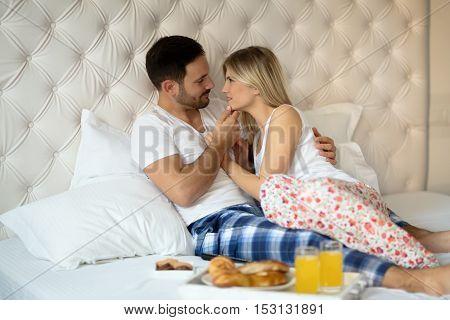 Romantic loving couple in morning in bed