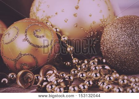 Festive Gold Christmas Decorations On Fabric Background Vintage Retro Filter.