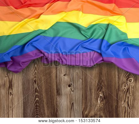 Rainbow flag as a background on wood