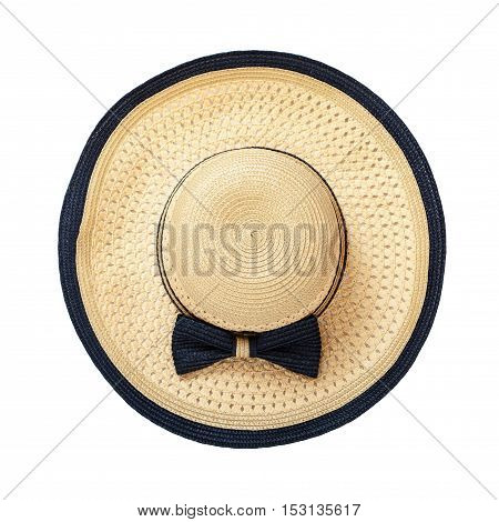 Pretty straw hat with ribbon and bow on white background. Beach hat close up top view isolated