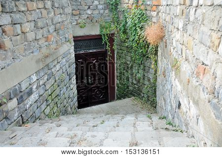 A wooden doorway at the bottom of stone steps within the Nanjing City wall in Jiangsu province China.