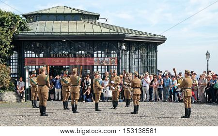BUDAPEST HUNGARY - SEPTEMBER 29 2016: Tourists watching the changing of the Guard ceremony in front of the presidential palace in Budapest