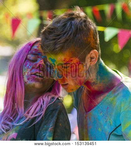 Lviv Ukraine - August 28 2016: Young people speak during the festival of color in a city park in Lviv.
