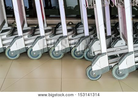 baggage trolleys at airport. Abstract Row of baggage cart in the airport
