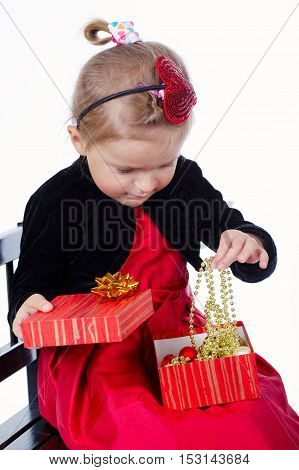 little happy girl with gift on white background
