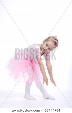 little girl ballerina dancer on bright background