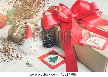 Gift box on white wooden background with decorations Christmas theme