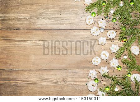 Christmas background of fir branches and ginger cookies