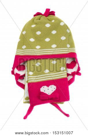 Green knitted hat with polka dots and scarf. Isolate on white.
