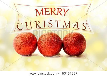 Christmas card with red baubles on bokeh background