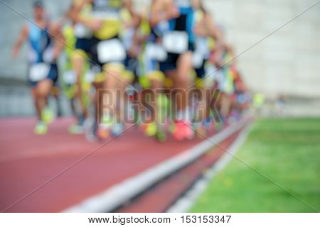Athletics people running on the track field,blur image abstract