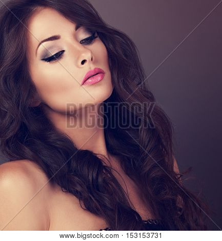 Beautiful Chic Female Makeup Model Posing With Long Curly Volume Hairstyle On Grey Background. Close