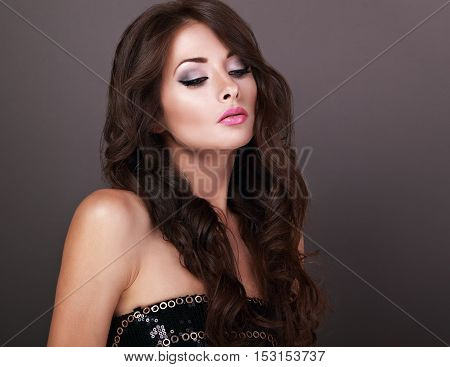 Beautiful Chic Female Makeup Model Posing With Long Curly Volume Hairstyle On Grey Background