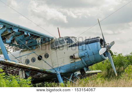 Old russian biplane aircraft An-2 at an abandoned