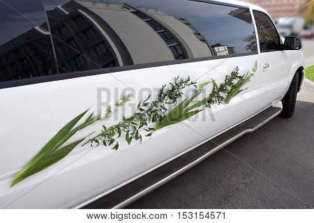 A wedding car decorated. Luxury wedding car decorated with flowers.