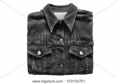 Folded black denim shirt on white background