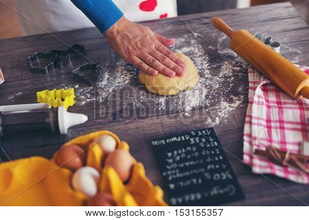 Preparation of gingerbread cookies on wooden background