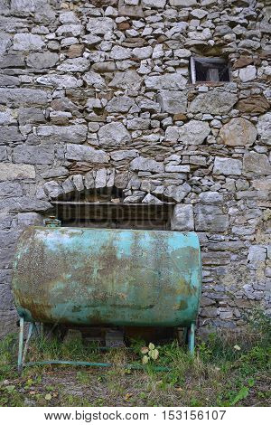 An old usted water tank in the north east Italian village of Oblizza