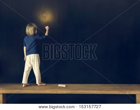 Little Girl Writing Blackboard Concept