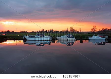 Boats in the countryside from the Netherlands at sunset