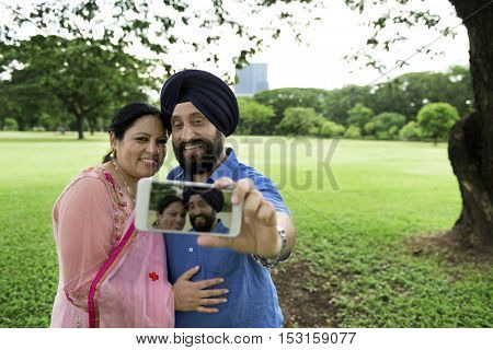 Indian Couple Taking Pictures Concept
