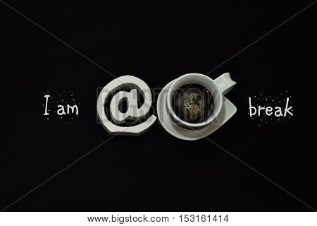 I am at coffeebreak. Black backgound. White text. White Espressocup. Espresso