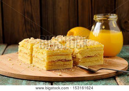 Homemade tasty lemon cake with lemon curd on bamboo plate closeup