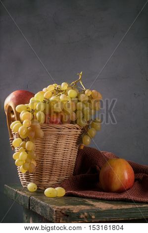 Grapes And Apples In A Basket