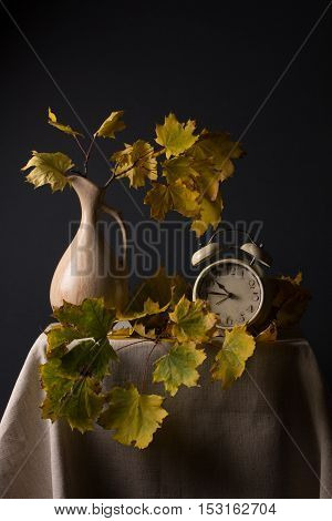 Still Life With Autumn Leaves And An Alarm Clock