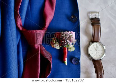 Beautiful wedding clothes for groom and for businessman. Beauty of business accessories indoors. Close-up jewel of marriage. Male decoration for couple. Jewelry for man