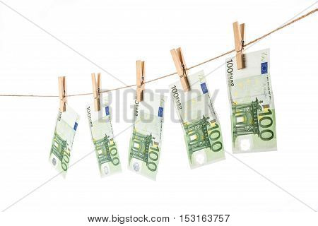 100 Euro Banknotes Hanging On Clothesline On White Background.