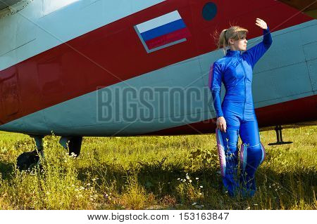 beautiful woman looking at the sun with airplane