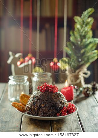 Christmas pudding on wooden table in rustic