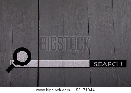 Internet search bar on black wooden background
