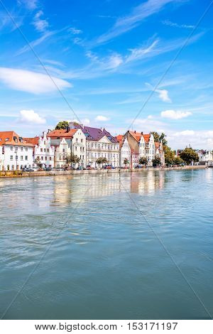 View on the riverside with beautiful buildings in Landshut town in Germany