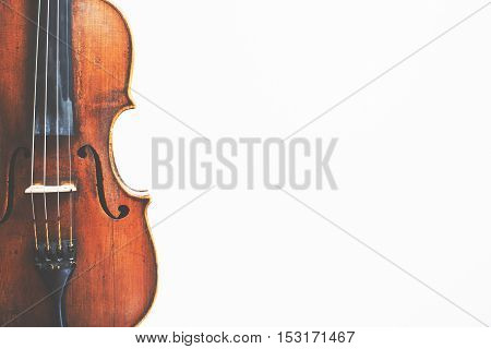Top view of violin placed vertically on white background with copy space