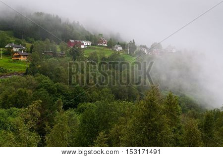 Weather event: Fog covers homes in the Norwegian mountains