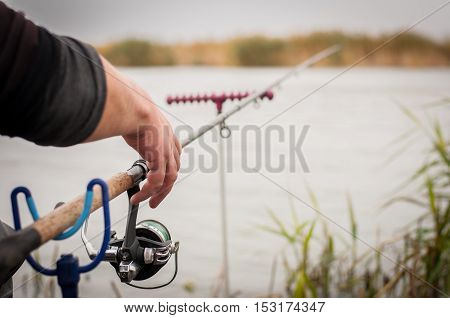 Fishing Rod With A Reel Near The River. Fishing On Carp, Bream.