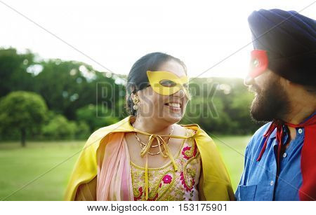 Indian Couple Superheroes Love Concept