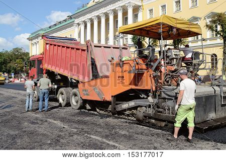 23.08.2015.Russia.Saint-Petersburg.Workflow for laying new asphalt.The street is hot.