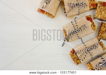 Granola bar on white wooden background. Healthy snack.