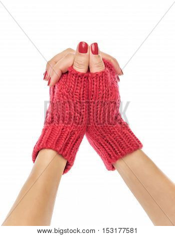 Female hands in mittens on a white background.