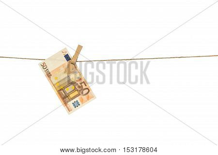 50 Euro Banknote Hanging On Clothesline On White Background.