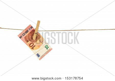10 Euro Banknote Hanging On Clothesline On White Background.