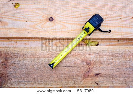 Measuring Tape On A Wooden Boards Background