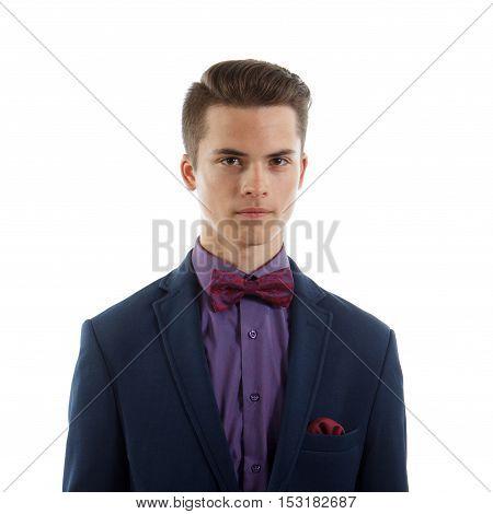 An elegant teenage boy wearing a suit